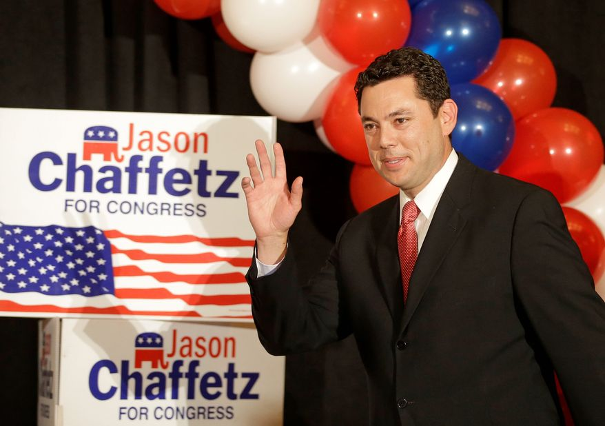 Rep. Jason Chaffetz, R-Utah, the winner of Utah's 3rd Congressional District, waves as he walks on stage during the Utah State GOP election night watch party Tuesday, Nov. 4, 2014, in Salt Lake City.  (AP Photo/Rick Bowmer)