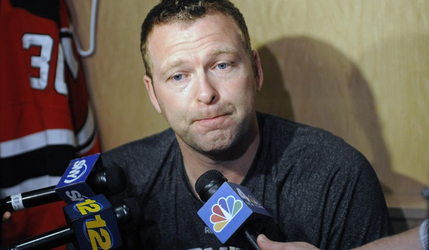 FILE - In this April 14, 2014, file photo, New Jersey Devils goaltender Martin Brodeur talks to the media as the NHL hockey team clean out their lockers in Newark, N.J. Brodeur isn't burning up his phone trying to find a place to play. While he lets his agent do that leg work, the legendary goaltender keeps working out and skating as much as he can in the hopes that his NHL career isn't over. Brodeur is the all-time leader in wins (688) and shutouts (124) and won three Stanley Cups with the Devils (1995, 2000 and 2003). (AP Photo/Bill Kostroun, File)