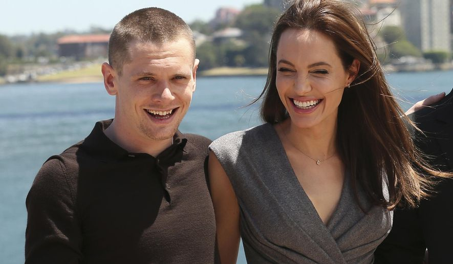 """CORRECTS SPELLING OF O'CONNELL - Angelina Jolie, who directed and produced the film """"Unbroken,"""" poses for a photo with actor Jack O'Connell after a press conference following the movie's world premiere in Sydney, Australia, Tuesday, Nov. 18, 2014. (AP Photo/Rob Griffith)"""