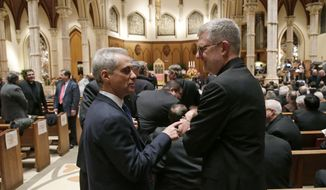 Chicago Mayor Rahm Emanuel, left, talks to DePaul University president the Rev. Dennis Holtschneider before the Rite of Reception service for the incoming archbishop Blase Cupich at Holy Name Cathedral, Monday, Nov. 17, 2014, in Chicago. Cupich will be installed as the ninth Archbishop of Chicago on Tuesday. He was named in September by Pope Francis to succeed the retiring Cardinal Francis George. (AP Photo/Charles Rex Arbogast)