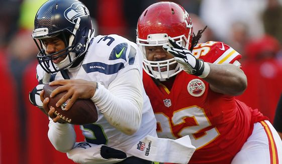 Kansas City Chiefs nose tackle Dontari Poe (92) sacks Seattle Seahawks quarterback Russell Wilson (3) in the second half of an NFL football game in Kansas City, Mo., Sunday, Nov. 16, 2014. The Chiefs won 24-20. (AP Photo/Ed Zurga)