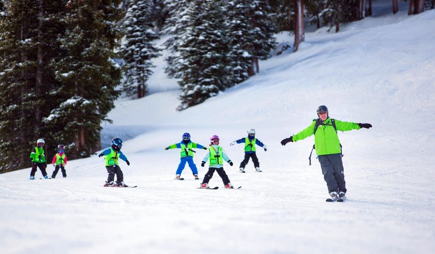 This undated photo provided by Arapahoe Basin Ski Area in Colorado shows a group of children practicing their ski moves with an instructor. Arapahoe is smaller than some of the bigger-name resorts, but as with many satellite ski areas, the slopes and lift lines may be less crowded and the vibe more relaxed than at some of the better-known places. (AP Photo/Arapahoe Basin Ski Area, Dave Camara)