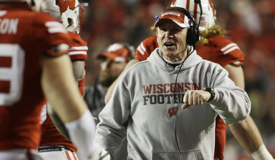 Wisconsin head coach Gary Andersen celebrates after a touchdown during the second half of an NCAA college football game against Nebraska Saturday, Nov. 15, 2014, in Madison, Wis. (AP Photo/Morry Gash)