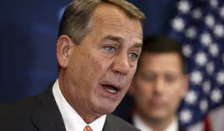 House Speaker John Boehner of Ohio, joined by Rep. Sean Duffy, R-Wis., meets with reporters on Capitol Hill in Washington, Tuesday, Nov. 18, 2014, following a House GOP caucus meeting.  (AP Photo/J. Scott Applewhite)