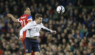 United States' Timmy Chandler, left, and Republic of Ireland's Anthony Pilkington in action during the international friendly soccer match at the Aviva stadium, Dublin, Ireland, Tuesday, Nov. 18, 2014. (AP Photo/Peter Morrison)