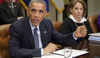 President Barack Obama meets with his National Security and Public Health teams to receive an update on the Ebola response, Tuesday, Nov. 18, 2014, in the Roosevelt Room of the White House in Washington. At right is Assistant to the President for Homeland Security and Counterterrorism Lisa Monaco. (AP Photo/Pablo Martinez Monsivais)