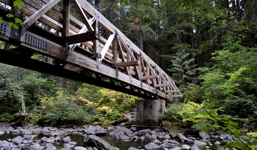 This photo taken on Sept. 27, 2012, shows one of the massive wood bridges along the trail to Bagby Hot Springs in the Mount Hood National Forest about 70 miles east of Salem, Ore. The hot springs in the Beaver State vary considerably. Some are wild outposts with naked hippies running around, others are pricy retreats and some are little known secrets. (AP Photo/Statesman-Journal, Danielle Peterson)