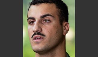 Marine Cpl. Wassef Ali Hassoun makes a statement to the media outside Quantico Marine Base in Quantico, Va., in this July 19, 2004, file photo. (AP Photo/Steve Helber, File)