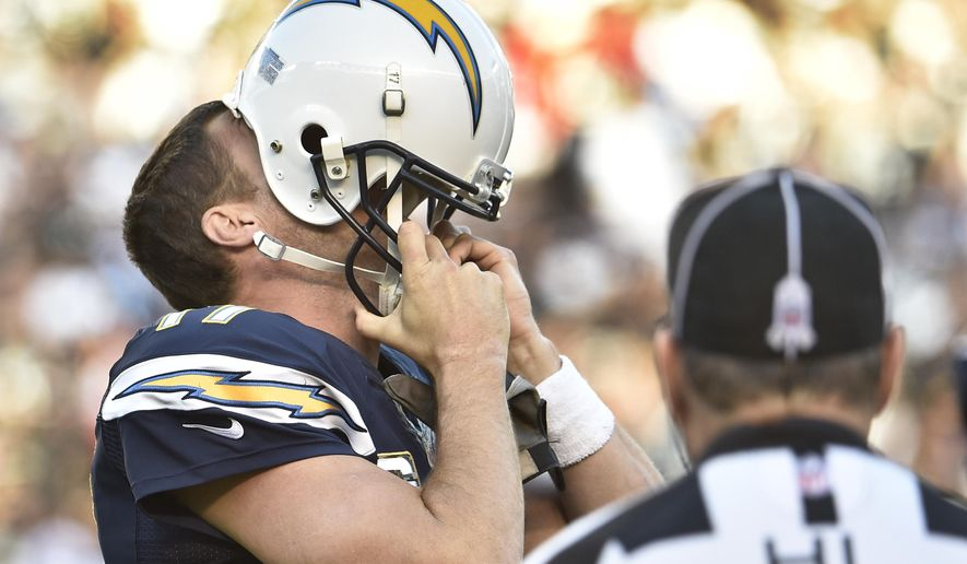 FILE - In this nov. 16, 2014, file photo, San Diego Chargers quarterback Philip Rivers hides his face in his helmet as he displays his frustration during the second half of the Chargers' 13-6 victory over the Oakland Raiders in an NFL football game in San Diego. The Raiders have gone a calendar year without a victory. (AP Photo/Denis Poroy, File)