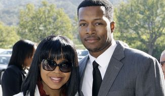 Flex Alexander and wife Shanice Wilson (AP Photo/Reed Saxon)