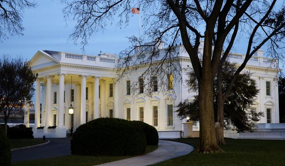 The White House is seen at dusk in Washington on Nov. 19, 2014. (Associated Press) **FILE**