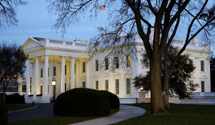 The White House is seen at dusk in Washington, Wednesday, Nov. 19, 2014. (AP Photo/Jacquelyn Martin) ** FILE **