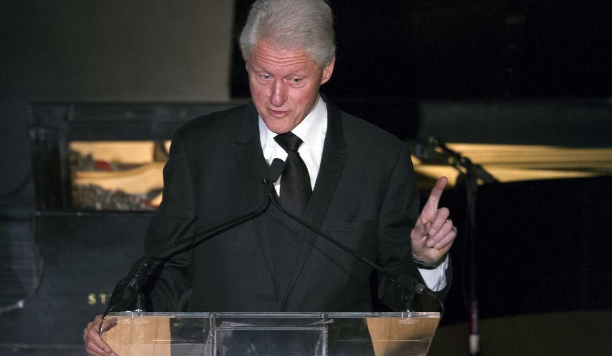 Former President Bill Clinton gives the keynote speech at the New Republic Centennial Gala Dinner at the Andrew Mellon Auditorium in Washington, Wednesday, Nov. 19, 2014. (AP Photo/Cliff Owen)