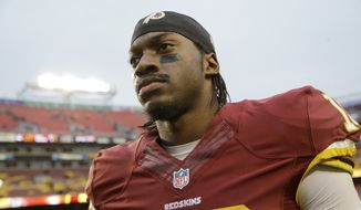Washington Redskins quarterback Robert Griffin III (10) walks off the field after an NFL football game against the Tampa Bay Buccaneers in Landover, Md., Sunday, Nov. 16, 2014. The Buccaneers defeated the Redskins 27-7. (AP Photo/Patrick Semansky)