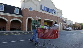 An unidentified customer leaves a Lowe's home improvement store in Charlotte, N.C., Tuesday, Nov. 18, 2014. Lowe's reports quarterly financial results on Wednesday, Nov. 19, 2014. (AP Photo/Chuck Burton)