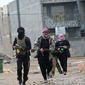 Gunman clash with Iraqi security forces in Fallujah, Iraq, Jan. 5, 2014. (Associated Press) ** FILE **