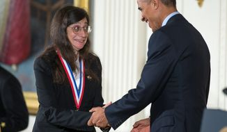 May Berenbaum, of the University of Illinois at Urbana-Champaign, shakes President Obama's hand as he awarded her the National Medal of Science during a ceremony at the White House on Thursday. The president presented this year's top national awards for science, technology and innovation. (Associated Press)