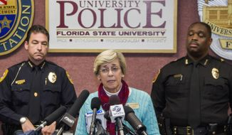 Mary Coburn, vice president of student affairs, center, talks to the media during a news conference about a shooting at the Strozier Library on the Florida State University campus, Thursday, Nov. 20, 2014, in Tallahassee, Fla. (AP Photo/Mark Wallheiser)