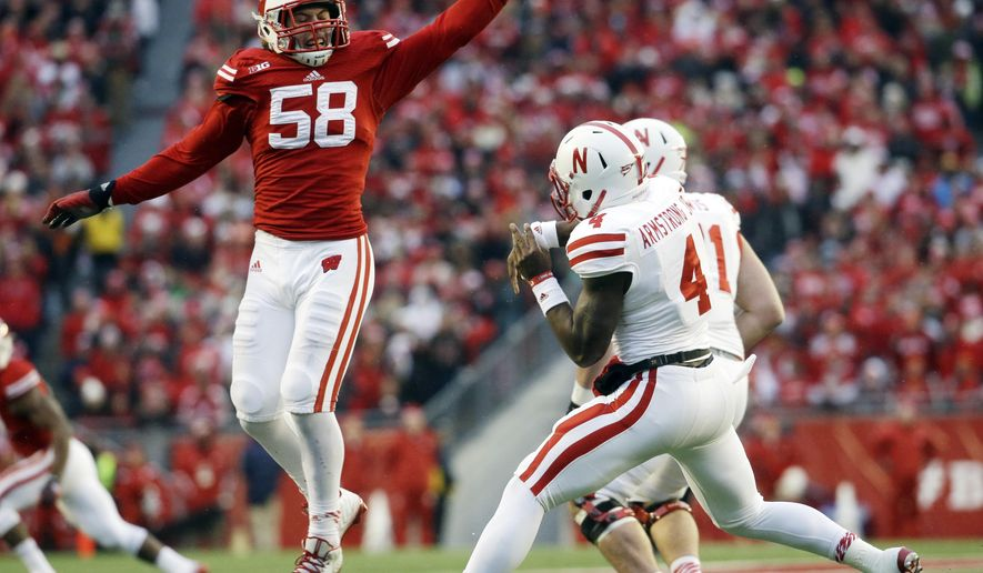 Wisconsin's Joe Schobert knocks down a pass by Nebraska quarterback Tommy Armstrong Jr. (4) during the first half of an NCAA college football game Saturday, Nov. 15, 2014, in Madison, Wis. (AP Photo/Morry Gash)