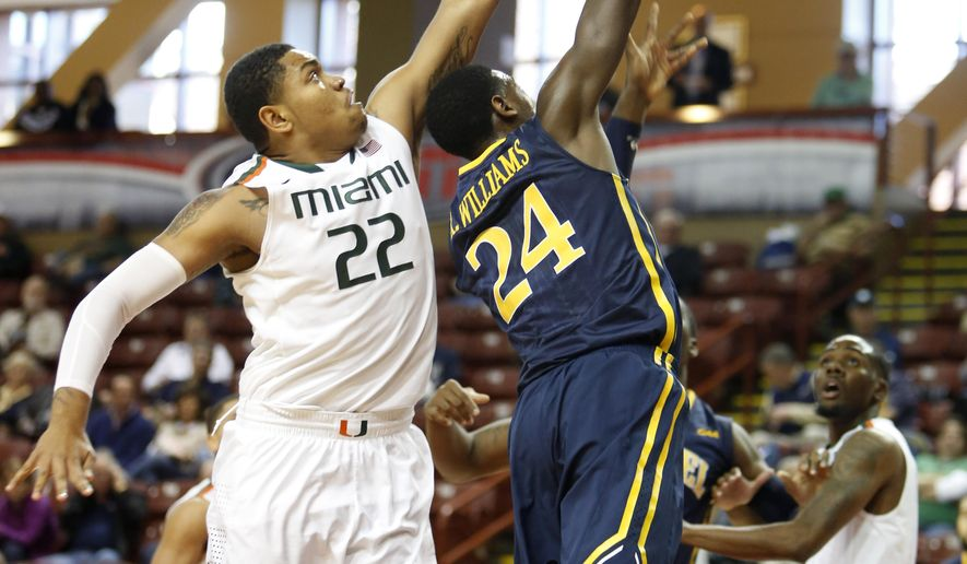 Miami's Omar Sherman, left, blocks the shot of Drexel's Rodney Williams during the first half at the Charleston Classic NCAA college basketball tournament in Charleston, S.C.,Thursday, Nov. 20, 2014. (AP Photo/Mic Smith)