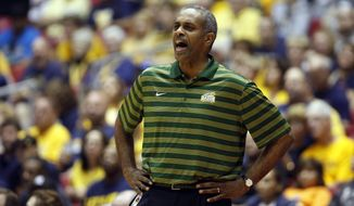 George Mason basketball coach Paul Hewitt yells out instructions to his players during the first half of an NCAA college basketball game against West Virgini in San Juan, Puerto Rico, Thursday, Nov. 20, 2014. (AP Photo/Ricardo Arduengo) **FILE**