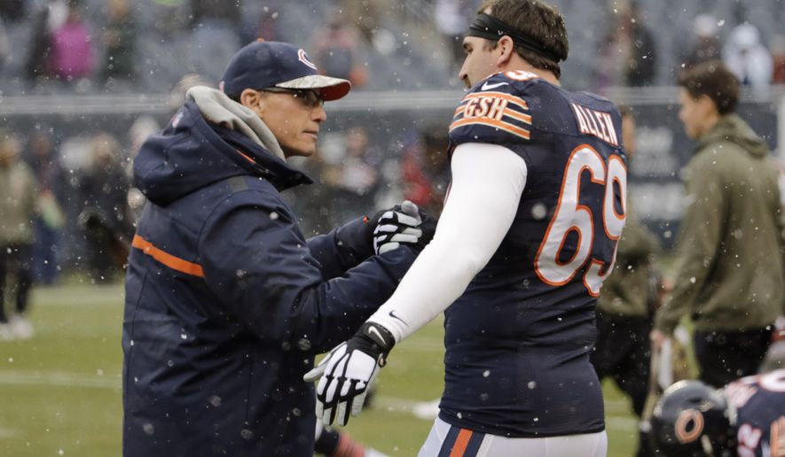Chicago Bears head coach Marc Trestman talks to defensive end Jared Allen (69) before an NFL football game against the Minnesota Vikings Sunday, Nov. 16, 2014 in Chicago. (AP Photo/Charles Rex Arbogast)
