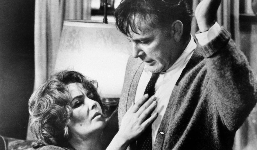 """FILE - In this 1966 file photo originally released by Warner Bros., Elizabeth Taylor, left, and Richard Burton, are shown in a scene from the film, """"Who's Afraid of Virginia Woolf."""" The film was directed by Mike Nichols, who died Wednesday, Nov. 20, 2014, at age 83. (AP Photo/Warner Bros., file)"""
