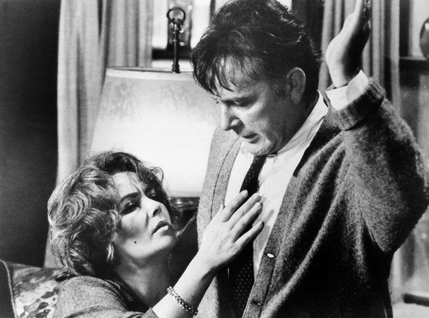 "FILE - In this 1966 file photo originally released by Warner Bros., Elizabeth Taylor, left, and Richard Burton, are shown in a scene from the film, ""Who's Afraid of Virginia Woolf."" The film was directed by Mike Nichols, who died Wednesday, Nov. 20, 2014, at age 83. (AP Photo/Warner Bros., file)"