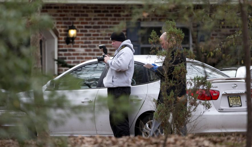Investigators worn the scene of a shooting Thursday, Nov. 20, 2014, in Tabernacle, N.J. New Jersey State Police say two people are dead and two were found wounded in a shooting in the southern New Jersey home. (AP Photo/Matt Rourke)
