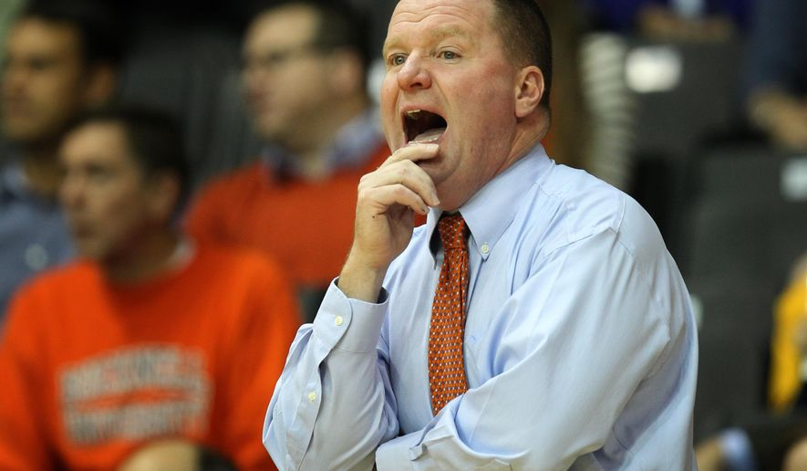 Bucknell coach Dave Paulson shouts from the bench in the first half of an NCAA college basketball game against Villanova, Thursday, Nov. 20, 2014, in Villanova, Pa. Villanova won 72-65. (AP Photo/Laurence Kesterson)