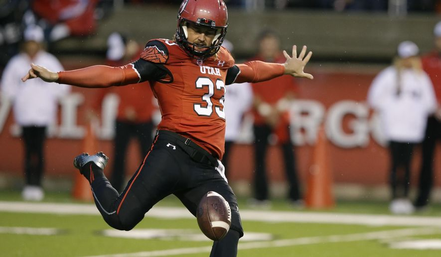 FILE - In this Sept. 27, 2014, file photo, Utah's Tom Hackett (33) punts in the first half during an NCAA college football game against Washington State in Salt Lake City. The rugby style of punting that Hackett uses, is spreading across college football. (AP Photo/Rick Bowmer, File)