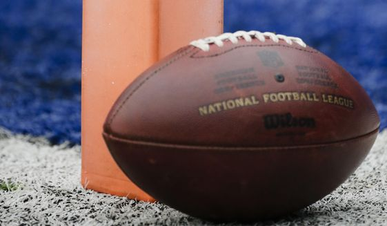 A football sits near the pylon marking the end zone as teams warms up before an NFL football game between the New York Giants and the San Francisco 49ers Sunday, Nov. 16, 2014, in East Rutherford, N.J.  Federal drug enforcement agents showed up unannounced Sunday to check at least three visiting NFL teams' medical staffs as part of an investigation into former players' claims that teams mishandled prescription drugs. There were no arrests, Drug Enforcement Administration spokesman Rusty Payne said Sunday, Nov. 16, 2014. The San Francisco 49ers' staff was checked at MetLife Stadium in East Rutherford, New Jersey, after they played the New York Giants. The Tampa Bay Buccaneers' staff was checked at Baltimore-Washington International airport after playing the Redskins. The Seattle Seahawks, who played at Kansas City, confirmed via the team's Twitter account that they were spot-checked as well. (AP Photo/Julio Cortez)