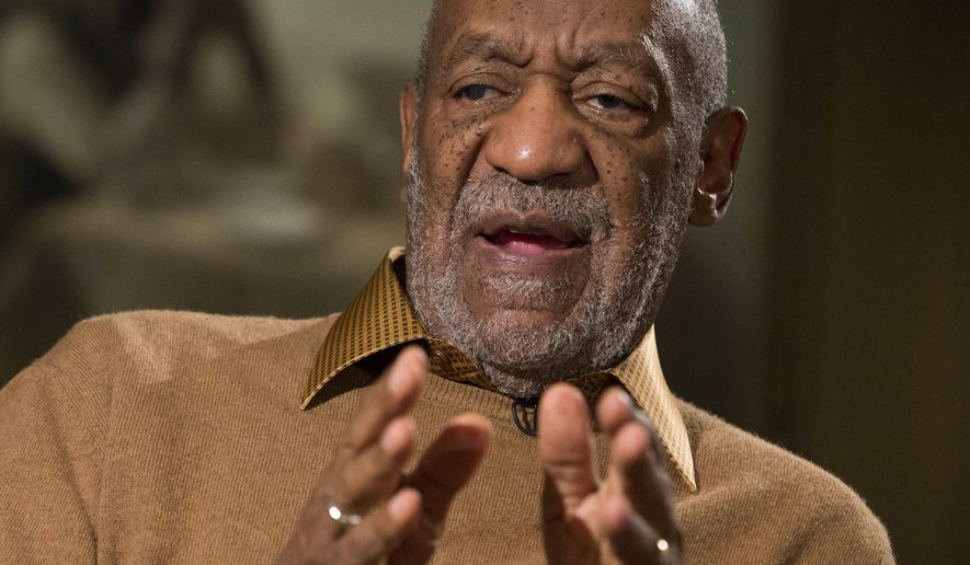 """In this Nov. 6, 2014, entertainer Bill Cosby, 77, gestures during an interview about the upcoming exhibit, """"Conversations: African and African-American Artworks in Dialogue,"""" at the Smithsonian's National Museum of African Art. (AP Photo/Evan Vucci, File)"""