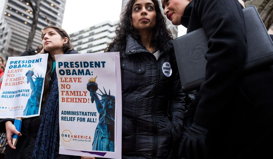 Supporters gather during a rally organized by OneAmerica as part of a National Week of Action to demand robust executive measures to stop deportations and keep families together Thursday, November 20, 2014, in Seattle. President Barack Obama is expected to announce his plan to use executive action to partially change the nation's immigration system Thursday night. (AP Photo/seattlepi.com, Jordan Stead)