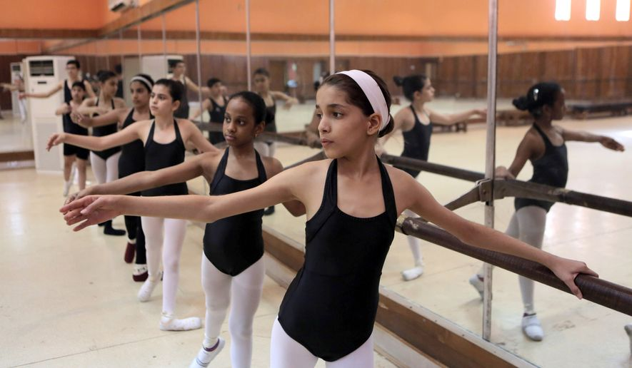 In this Nov. 12, 2014, photo, students practice at the Baghdad School of Music and Ballet in Monsur district in Baghdad, Iraq. The school has managed to survive decades of turmoil, a feat that speaks to the resilience of Baghdad's residents through war after war. (AP Photo/Khalid Mohammed)