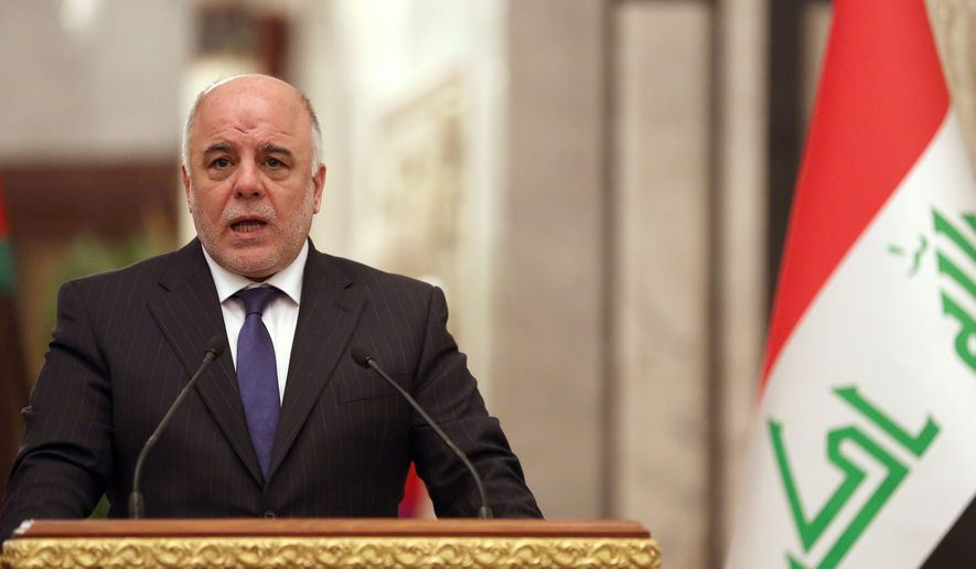 Iraqi prime Minister Haider al-Abadi, speaks at a press conference with Turkey's  Prime Minister Ahmet Davutoglu in Baghdad, Iraq, Thursday, Nov. 20, 2014. Iraq's prime minister said on Thursday that his country and neighboring Turkey have agreed on closer security and intelligence cooperation in the face of the threat posed by the Islamic State group. (AP Photo/Hadi Mizban, Pool)