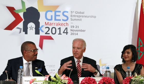 US Vice President Joe Biden, center,  gestures as he addresses entrepreneurs from around the Middle East during the opening session of the the Global Entrepreneurship Summit in Marrakech, Morocco, Thursday, Nov. 20, 2014. US ambassador to Morocco Dwight Bush is seated left and Moroccan entrepreneur Yasmine El Baggari right. Biden is attending the 5th annual Global Entrepreneurship Summit established by the U.S. in the latest vote of confidence for this North African kingdom. (AP Photo/Paul Schemm)