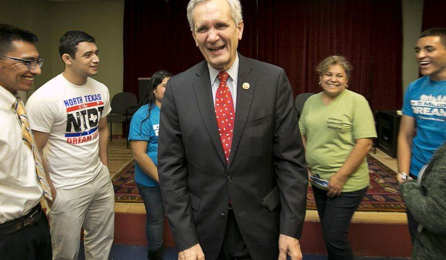 Rep Lloyd Doggett (center) visits with immigration rights supporters after a rally at the Workers Defense Project in Austin, Texas, on Friday, Nov. 21, 2014. Left to right are Victor Garcia, Fernando Violante, Rubi Espiricueta, Maricela Galvan and Alfredo Galvan. (AP Photo/Austin American-Statesman, Jay Janner) **FILE**