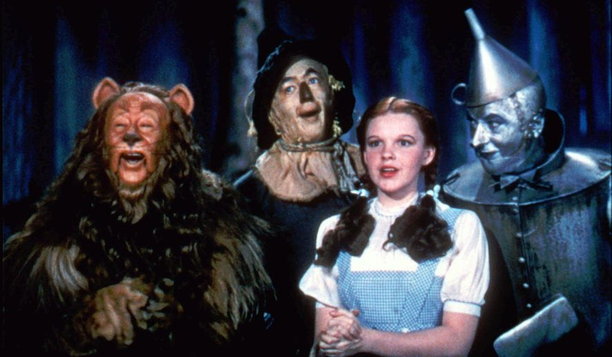 "In this 1939 file photo originally released by Warner Bros., from left, Bert Lahr as the Cowardly Lion, Ray Bolger as the Scarecrow, Judy Garland as Dorothy, and Jack Haley as the Tin Woodman, are shown in a scene from ""The Wizard of Oz."" (AP Photo/Warner Bros., file) ** FILE **"