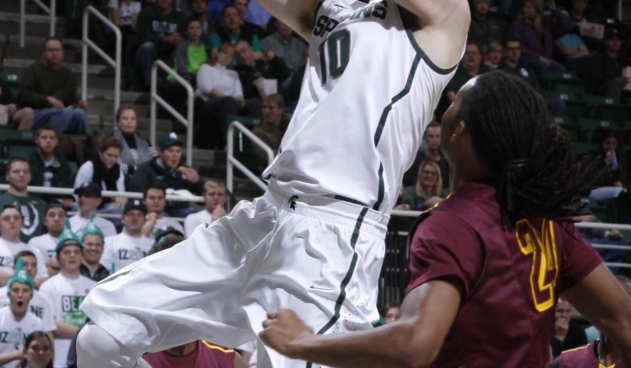 Michigan State's Matt Costello (10) puts up a layup against Loyola's Montel James, right, during the first half of an NCAA college basketball game, Friday, Nov. 21, 2014, in East Lansing, Mich. (AP Photo/Al Goldis)