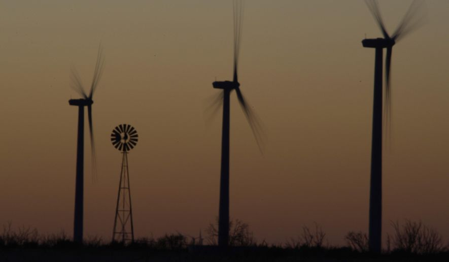 Wind mills work atop the mesa near Sterling City, Texas. (AP Photo/LM Otero, File)
