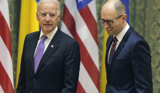 U.S. Vice President Joe Biden, left, talks with Ukrainian Prime Minister Arseniy Yatsenyuk during a meeting in Kiev, Ukraine, Friday, Nov. 21, 2014. (AP Photo/Efrem Lukatsky)