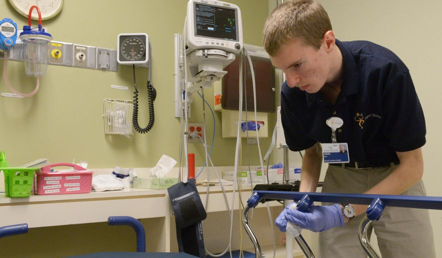 ADVANCED FOR RELEASE MONDAY, NOVEMBER 24, 2014 Alamance Regional Medical Center environmental services intern Jason Roby cleans a room in the hospital Monday Nov. 17, 2014 at Alamance Regional Medical Center in Burlington, N.C. (AP Photo/Burlington Times-News, Sam Roberts)