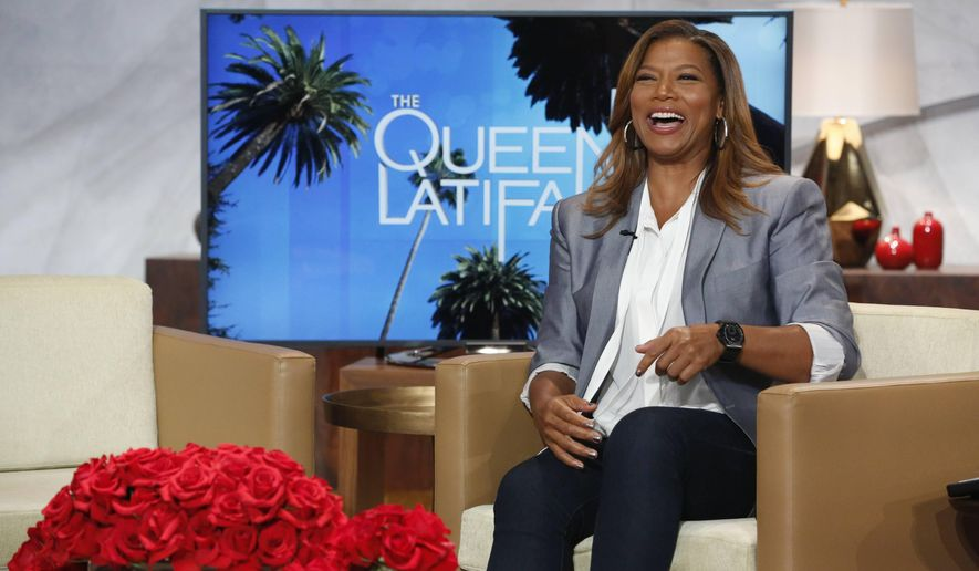 """In this undated photo provided by Sony Pictures Television, talk show host, Queen Latifah, laughs on the set of """"The Queen Latifah Show,"""" in Culver City, Calif.  """"The Queen Latifah Show"""" will be ending after this season. Distributor Sony Pictures Television said Friday, Nov. 21, 2014, the show will air original episodes through March 2015. (AP Photo/Sony Pictures Television)"""