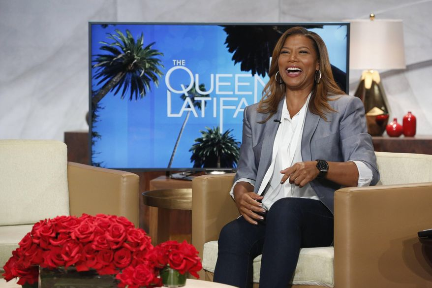 "In this undated photo provided by Sony Pictures Television, talk show host, Queen Latifah, laughs on the set of ""The Queen Latifah Show,"" in Culver City, Calif.  ""The Queen Latifah Show"" will be ending after this season. Distributor Sony Pictures Television said Friday, Nov. 21, 2014, the show will air original episodes through March 2015. (AP Photo/Sony Pictures Television)"