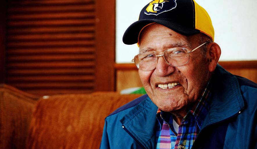 Ted Diaz of Rifle, 92, poses for a photo Friday, Nov. 21, 2014 in Rifle, Colo. Diaz hasn't missed a home Rifle Bears high school football game in 62 years. He'll be one of many in the stands when the Bears take on the Fort Morgan Mustangs at Bears Stadium in Rifle on Saturday, Nov. 22, 2014. (AP Photo/Glenwood Springs Post-Independent, ,Jon Mitchell)
