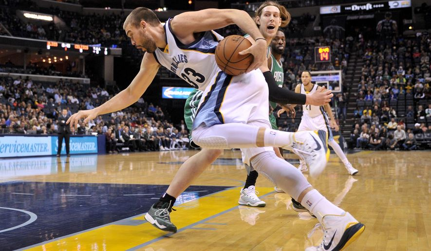 Memphis Grizzlies center Marc Gasol (33) drives past Boston Celtics center Kelly Olynyk in the first half of an NBA basketball game Friday, Nov. 21, 2014, in Memphis, Tenn. (AP Photo/Brandon Dill)
