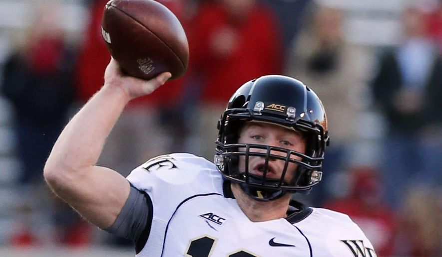 Wake Forest quarterback John Wolford (10) looks to pass during the first half of an NCAA college football game in Raleigh, N.C., Saturday, Nov. 15, 2014. (Associated Press) ** FILE **