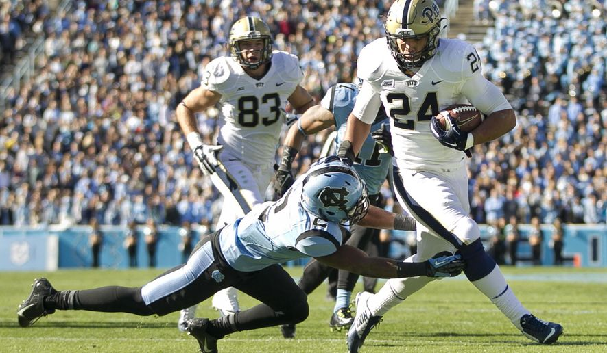 Pittsburgh's James Conner (24) rushes for a 16-yard touchdown ahead of North Carolina's Des Lawrence (2) in the second quarter of an NCAA college football game on Saturday, Nov. 15, 2014, in Chapel Hill, N.C. (AP Photo/The News & Observer, Robert Willett) MANDATORY CREDIT