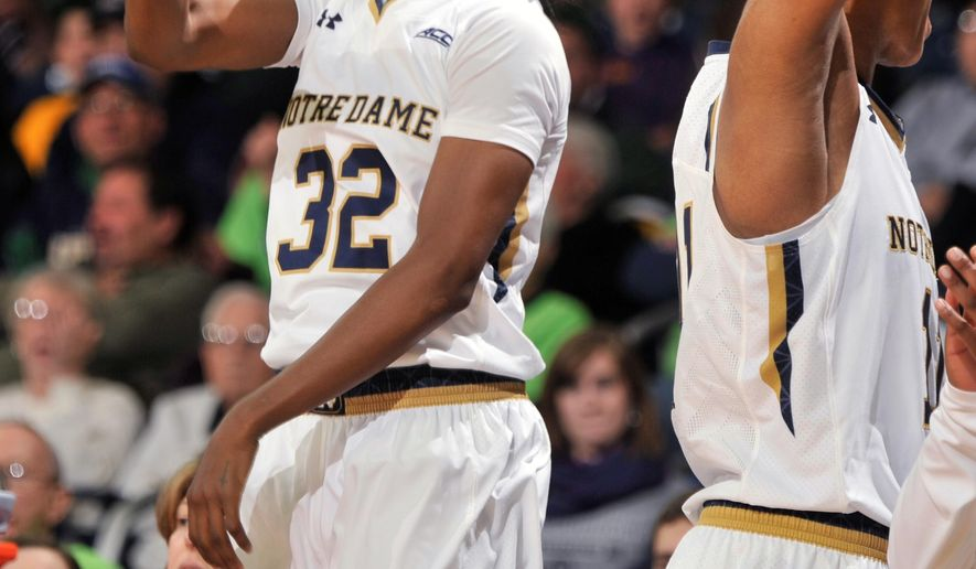 Notre Dame guard Jewell Loyd reacts to a basket by a teammate during the second half of an NCAA college basketball game against Chattanooga, Friday, Nov. 21, 2014, in South Bend, Ind. Loyd lead all scorers with 20 points. At right is forward Brianna Turner. Notre Dame won 88-53. (AP Photo/Joe Raymond)